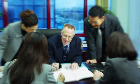 Manager discussing a project with his subordinates Stock Photo - 12645332