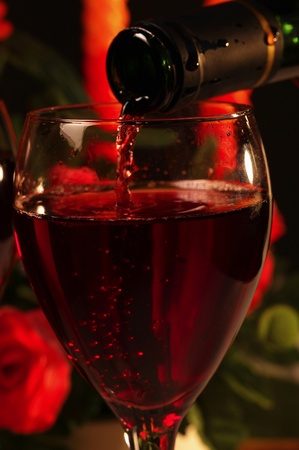 Red wine being poured into a glass Stock Photo - 12645334