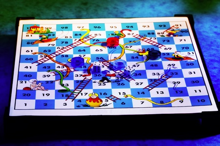 Snakes and ladders board with dices and tokens Stock Photo - 12645379