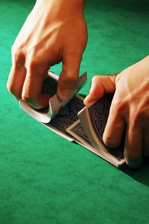 Hands shuffling a deck of cards Stock Photo - 12645390
