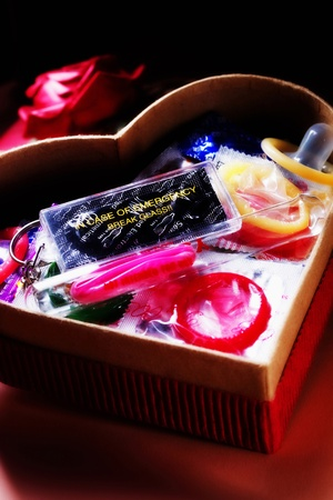 Various types of condoms in a heart shaped gift box Stock Photo - 12645428