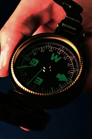 Hand holding a compass looking for direction Stock Photo - 12645435