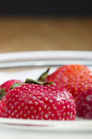 Strawberries being soaked in a bowl of milk Stock Photo - 12645542