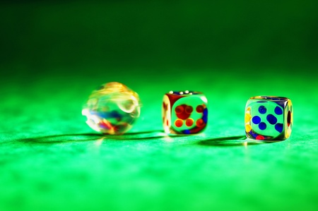Three dices on a green table Stock Photo - 12645711