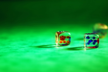 Three dices on a green table Stock Photo - 12645712