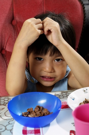 Girl eating cereal breakfast Stock Photo - 12645755