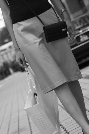 Waist down shot of woman carrying paper bags Stock Photo - 12645860