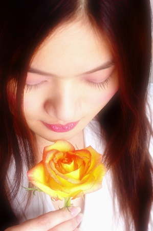 Top angle view of woman holding a yellow rose Stock Photo - 12645890