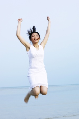 Woman jumping up with joy Stock Photo - 12735855