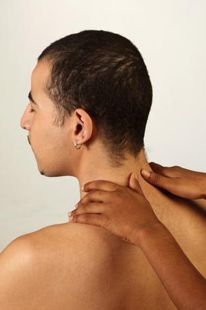 Hands massaging man's back Stock Photo - 12735936