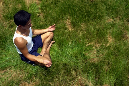 Top angle view of man meditating in the park Stock Photo - 12735967