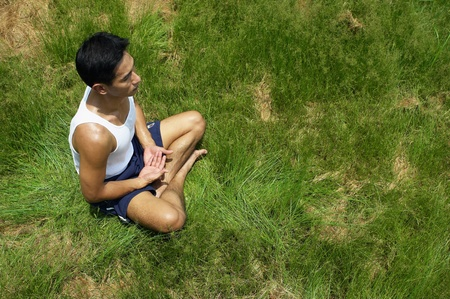 Top angle view of man meditating in the park Stock Photo - 12735968