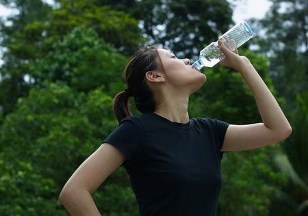 Woman drinking a bottled water Stock Photo - 12735976