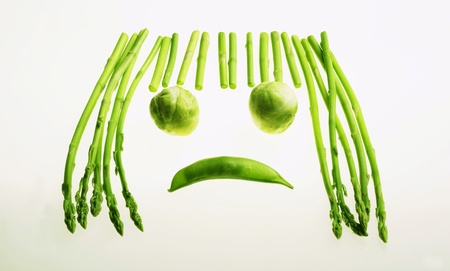 Forming a sad face with green vegetables Stock Photo - 12736026