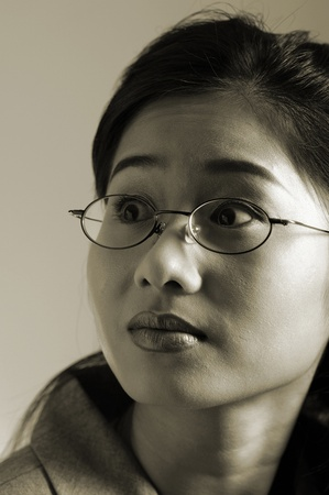 Sepia picture of a bespectacled business woman Stock Photo - 12736088