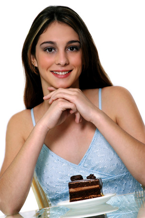 spaghetti strap: A woman in blue spaghetti top posing with a plate of chocolate cake LANG_EVOIMAGES