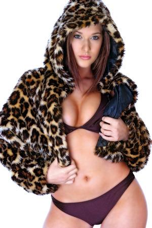 A woman in purple bikini wearing a hooded leopard skin jacket