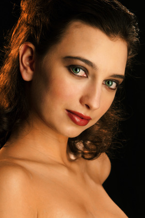 A portrait of a pretty woman with brown curly hair