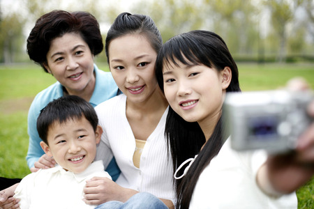 cool gadget: Woman taking picture with her family