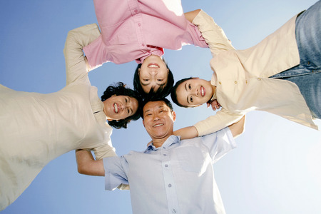 Family forming a circle