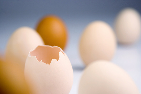 food staple: A broken egg standing among other whole eggs