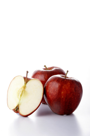 two and a half: Two whole and one half red apples LANG_EVOIMAGES