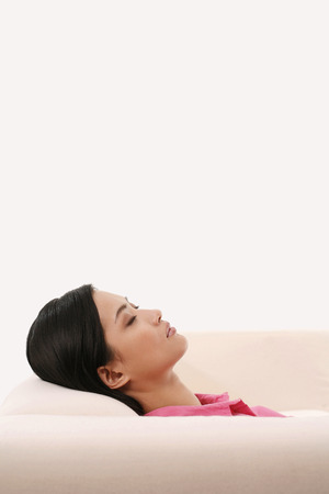 lethargy: Businesswoman relaxing on the couch LANG_EVOIMAGES