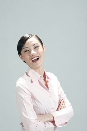 folding arms: Businesswoman laughing while folding her arms LANG_EVOIMAGES