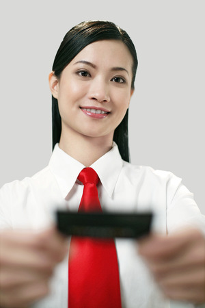 out of business: Businesswoman giving out business card