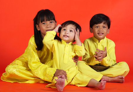 Studio shot of girl and her younger brothers LANG_EVOIMAGES