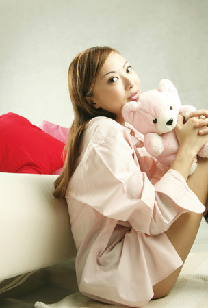 Woman posing with her teddy bear