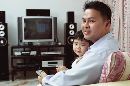 side shot: Side shot of man watching television with his daughter