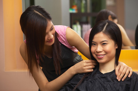 enquire: Hairdresser asking her customer about her favoured hairstyle