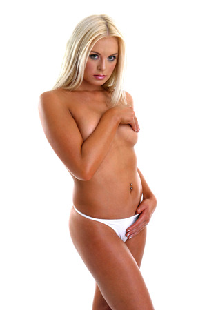 half nude: Topless woman posing for the camera