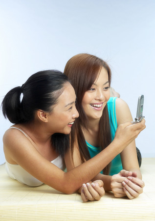 camera phone: Woman snapping picture with her camera phone