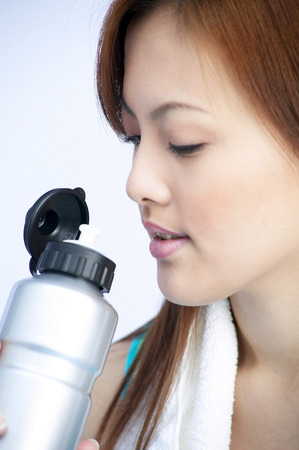 fatigued: Close-up picture of woman holding a water tumbler