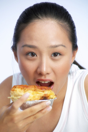 deliciously: Woman eating a deliciously looking gourmet pie LANG_EVOIMAGES