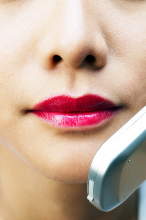 fair complexion: Close-up of woman with makeup talking on the handphone