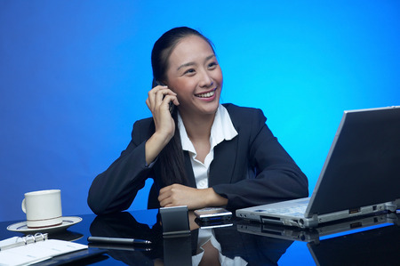 Business woman laughing while chatting with her client