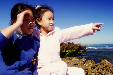 he   my sister: Two girls admiring the sea view from the top