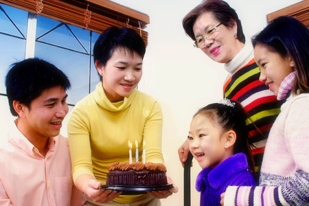motherly love: Girl celebrating her birthday with her family LANG_EVOIMAGES