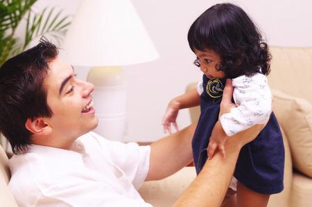 side shot: Side shot of man lifting up his daughter LANG_EVOIMAGES