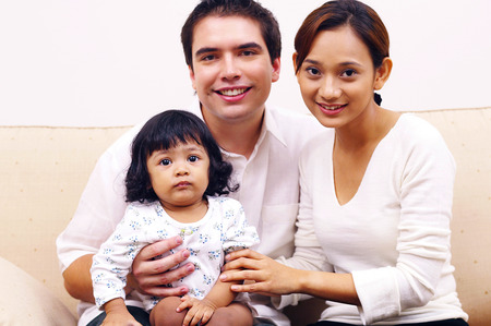 motherly love: Group shot of a couple and their daughter LANG_EVOIMAGES