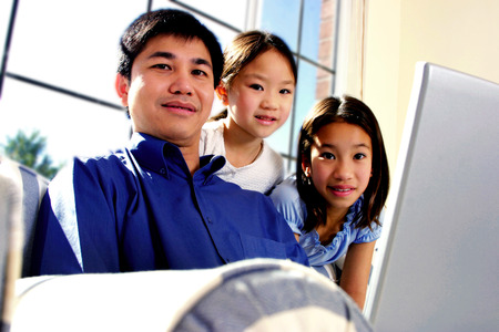he   my sister: Man posing with his two daughters in a study room