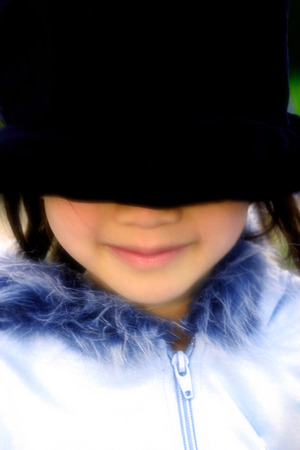 blindfolded: Close-up picture of a blindfolded girl in furry jacket LANG_EVOIMAGES