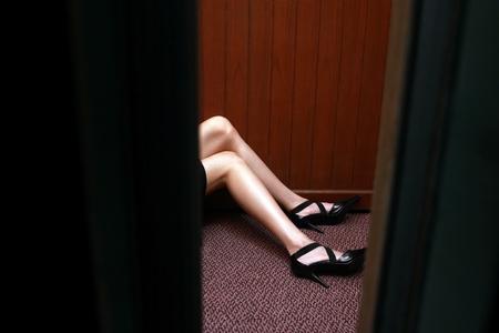 fainted: Businesswoman lying on the elevator floor.