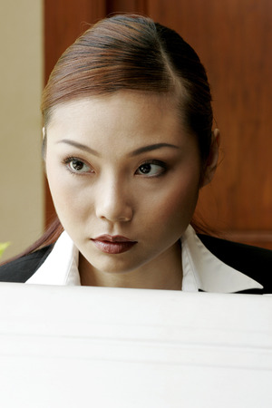 wasting away: Businesswoman staring blankly at a space.