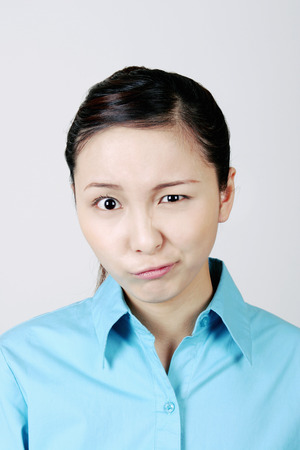 Woman making funny facial expression.