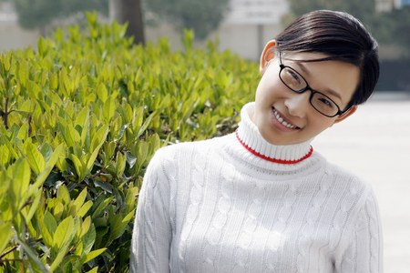 bespectacled: Bespectacled girl smiling at the camera.