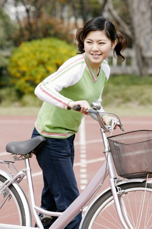 transportation: Girl with a bicycle.